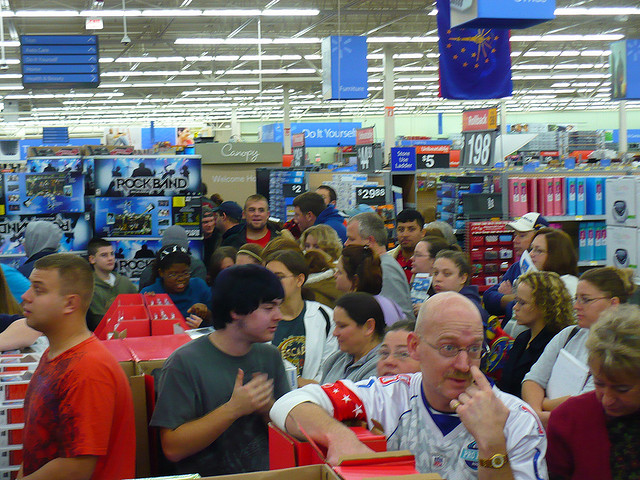 A picture of the chaos of Walmart on Black Friday. Customers everywhere in disordered lines, waiting to check out.